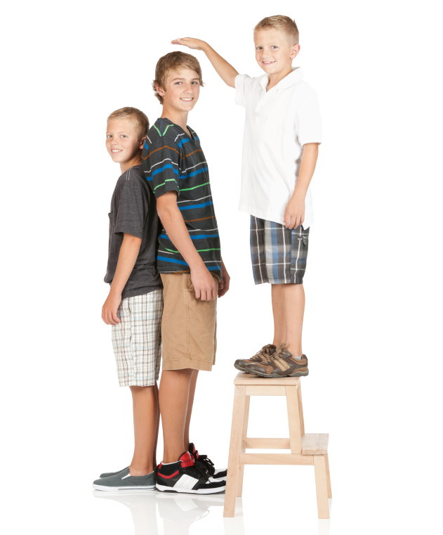 Three young boys of different height