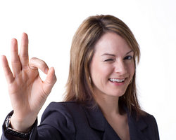 Businesswoman with a-okay hand gesture