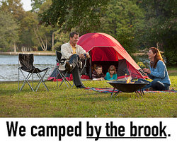 happy family camping by a river