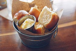 bowl of bread rolls and butter