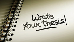 notebook with words write your thesis on the page