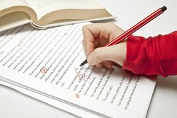 Proofreader with a red pen
