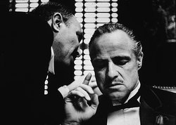 Marlon Brando with another man in still from The Godfather