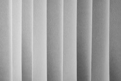 Grayscale layered paper in columns
