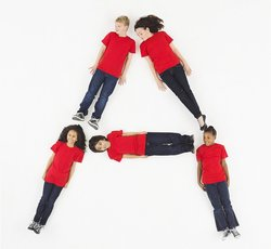 Children laying in letter A formation