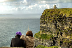 couple enjoying the view from cliff