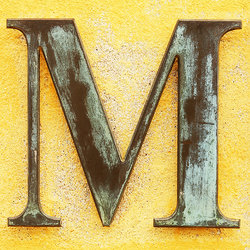 capital letter m on yellow