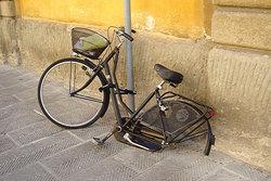 broken bicycle on sidewalk