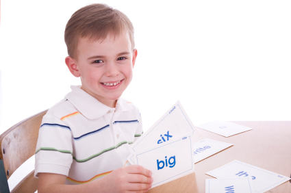 Happy boy learning with vocabulary flashcards