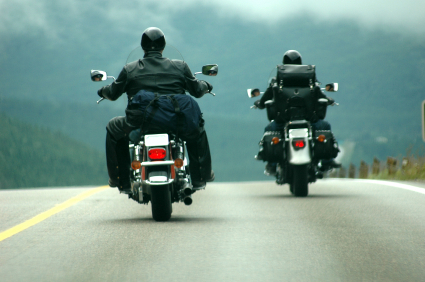 two bikers traveling down the highway