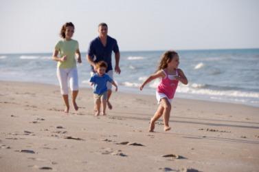 A family enjoying the seashore.