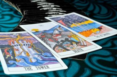 Three tarot cards.