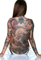 This woman has a lot of tattoos.
