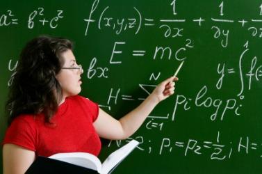 A woman teaching math.