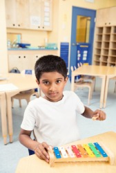 A child playing a xylophone.