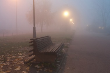 A park bench in the fog.