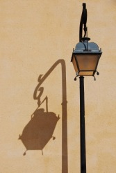 The streetlights shadow is an example of umbra.