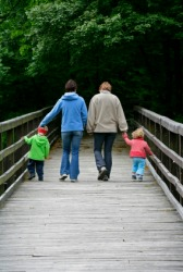 A family walks across a bridge.