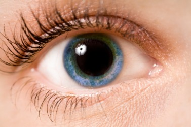 An eye with a dilated pupil.