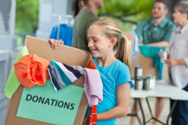 One disposal of old clothes is donating to charity.