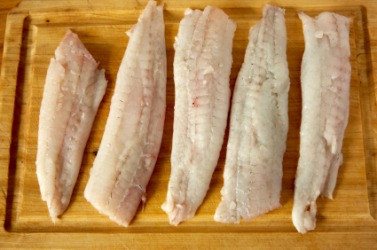 Fresh raw flounder fillets.