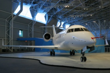 An airplane in a hangar.