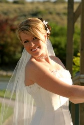 The brides faces reflects her happiness on her wedding day.