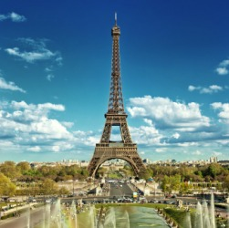 An example of iconic is The Eiffel Tower as a symbol of Paris.