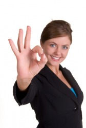 This woman gives the sign for OK!