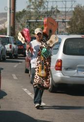 A street peddler selling guitars.