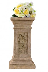 Flowers on a pedestal.