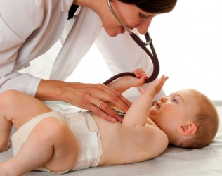 A baby being examined by a pediatrician.