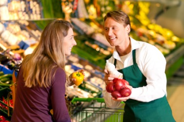 A woman receives quality service from her grocer.