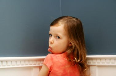 A child exhibiting bad behavior.