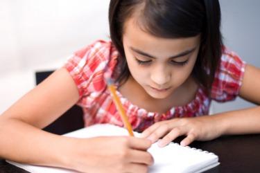 A girl doing her homework.