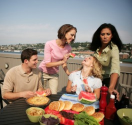 Entertaining friends at a rooftop picnic.