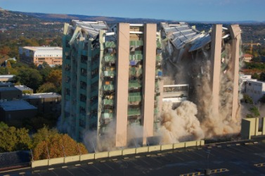 A building implodes.