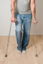 This mans injury causes him to limp.