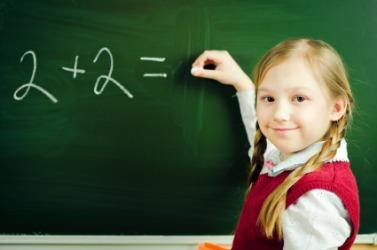A little girl learning basic math.