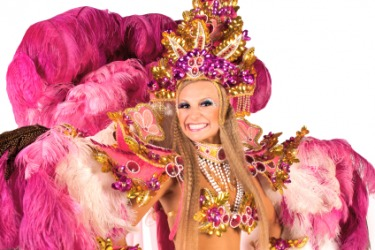 A carnival dancer wearing an ornate costume.