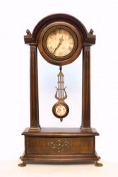 A pendulum in an old fashioned clock.