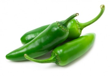A group of fresh jalapeno peppers.