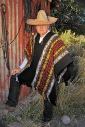 A man wearing a serape.