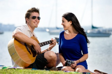 A man serenades his girlfriend.