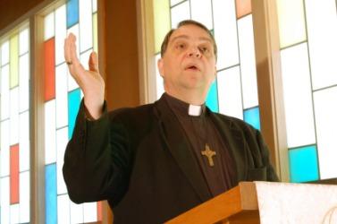 A priest delivering a sermon