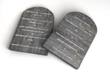 The Ten Commandments on stone tablets.