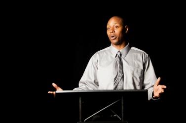 A man delivering a verbal presentation.