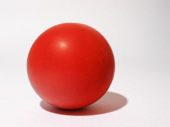 Red is an adjective to describe this ball.