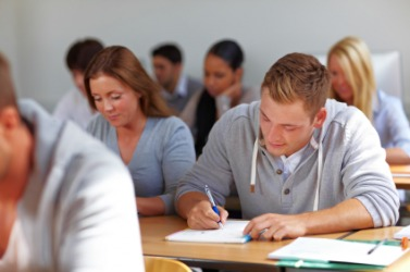 A group of students taking an exam.