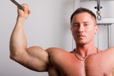 A man flexes his biceps.